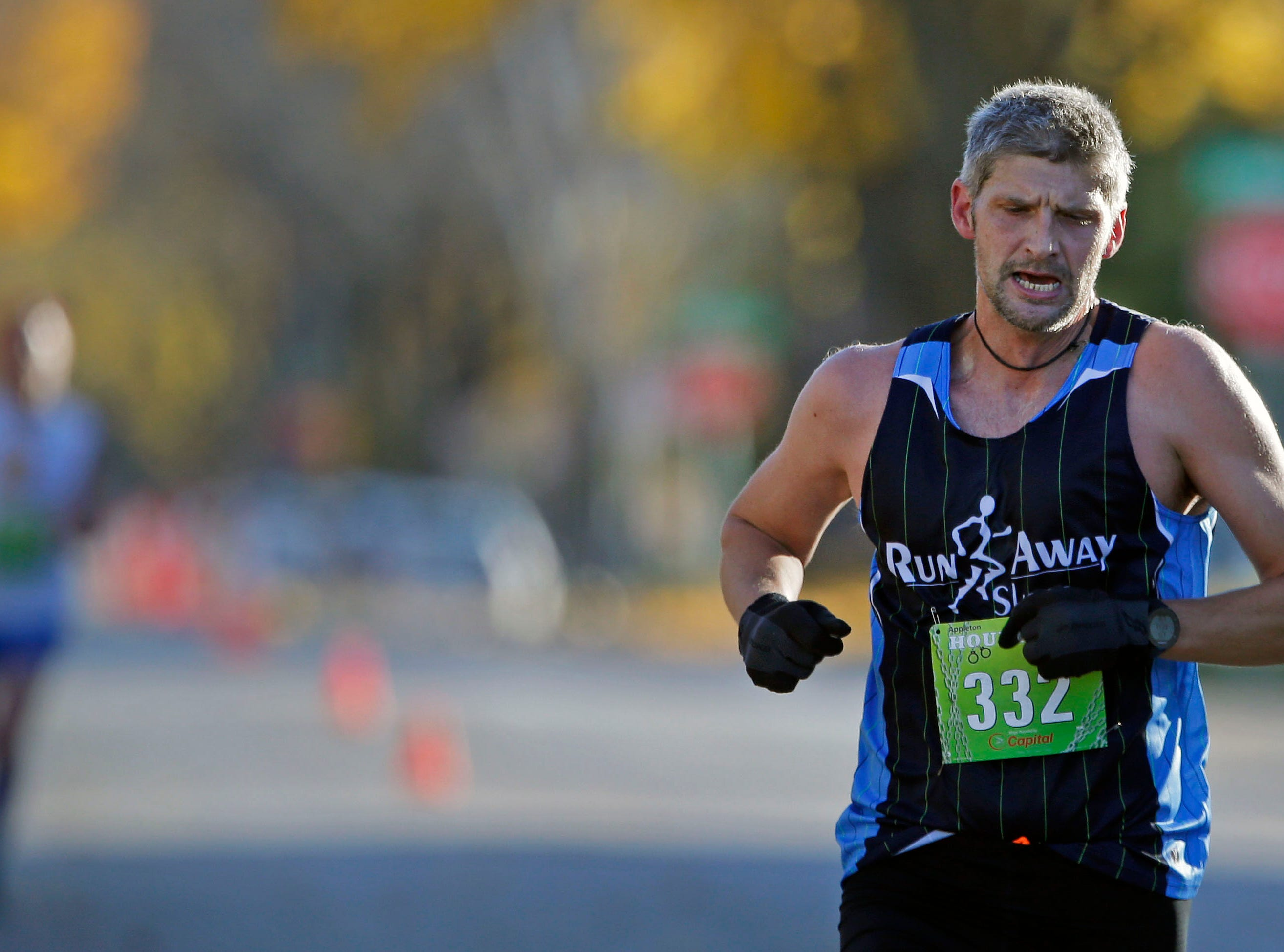 Michael Heidke nears the finish of the 4th annual Appleton Houdini 10K Saturday, November 3, 2018, in Appleton, Wis.Ron Page/USA TODAY NETWORK-Wisconsin