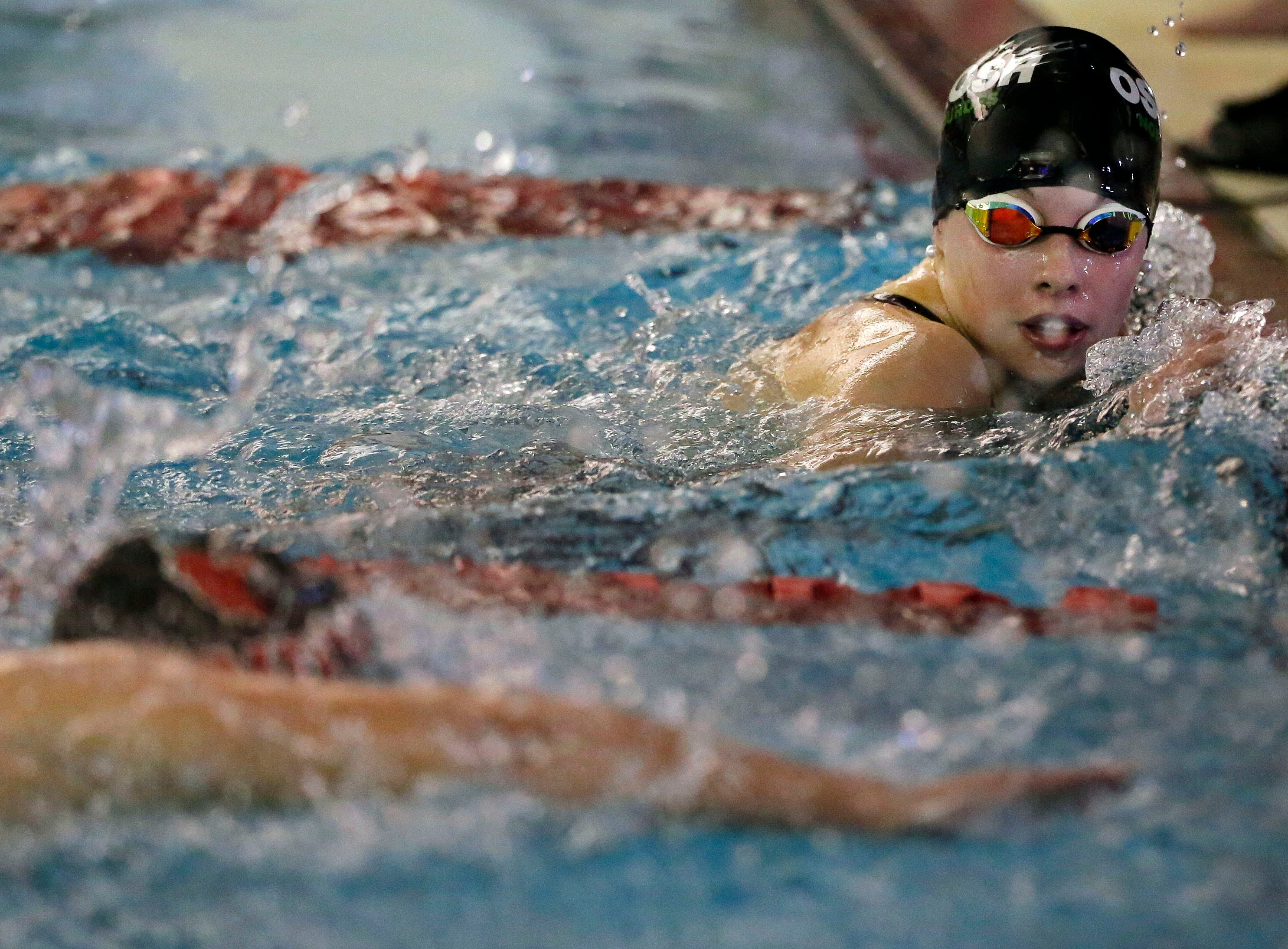 Ali Pecore of Oshkosh North/Lourdes watches as Grace Sphatt of Fond du Lac finishes the 500 Yard Freestyle as the WIAA Division 1 swimming sectional meet takes place Saturday, November 3, 2018, at Neenah High School in Neenah, Wis. Winners advanced to state.Ron Page/USA TODAY NETWORK-Wisconsin