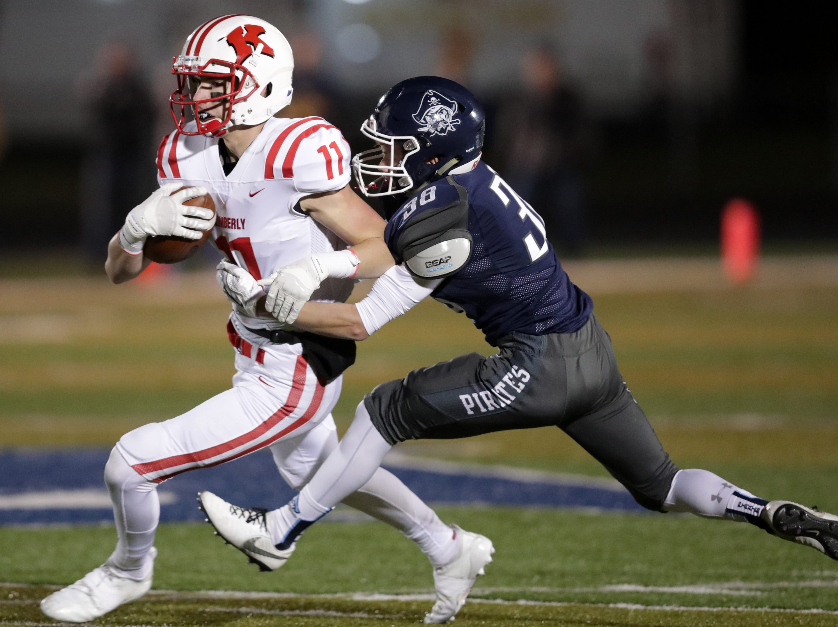 Kimberly High School's #11 Conner Wnek against Bay Port High School's #38 Owen Miller during their WIAA Division 1 state quarterfinal football game on Friday, November 2, 2018, in Suamico, Wis.  Kimberly defeated Bay Port 38 to 20. Wm. Glasheen/USA TODAY NETWORK-Wisconsin.