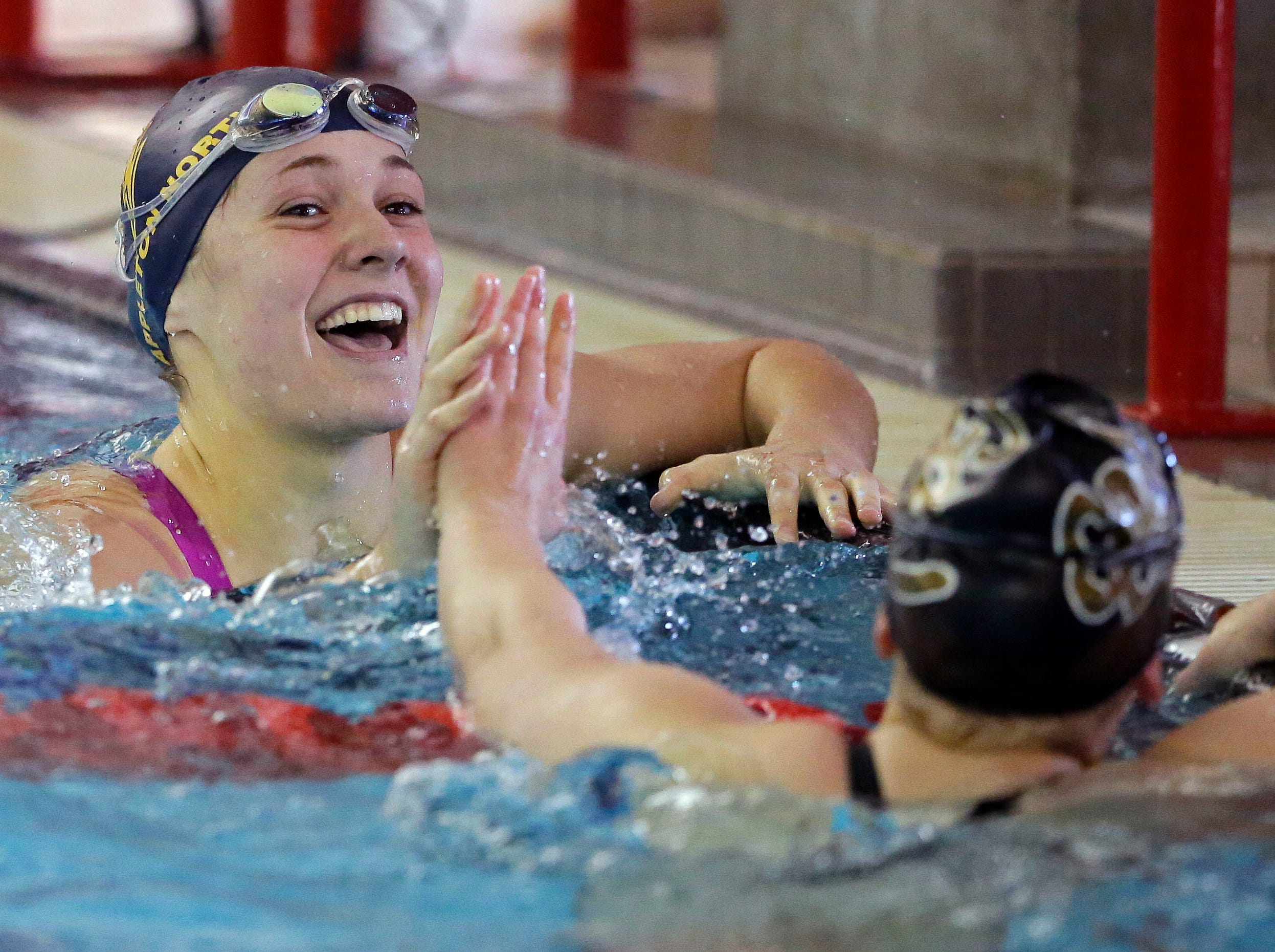 Joy Vandenberg of Appleton North and Annabelle Metzler of Green Bay SW have congratulations for each other at the finish of the 50 Yard Freestyle as the WIAA Division 1 swimming sectional meet takes place Saturday, November 3, 2018, at Neenah High School in Neenah, Wis. Winners advanced to state.Ron Page/USA TODAY NETWORK-Wisconsin