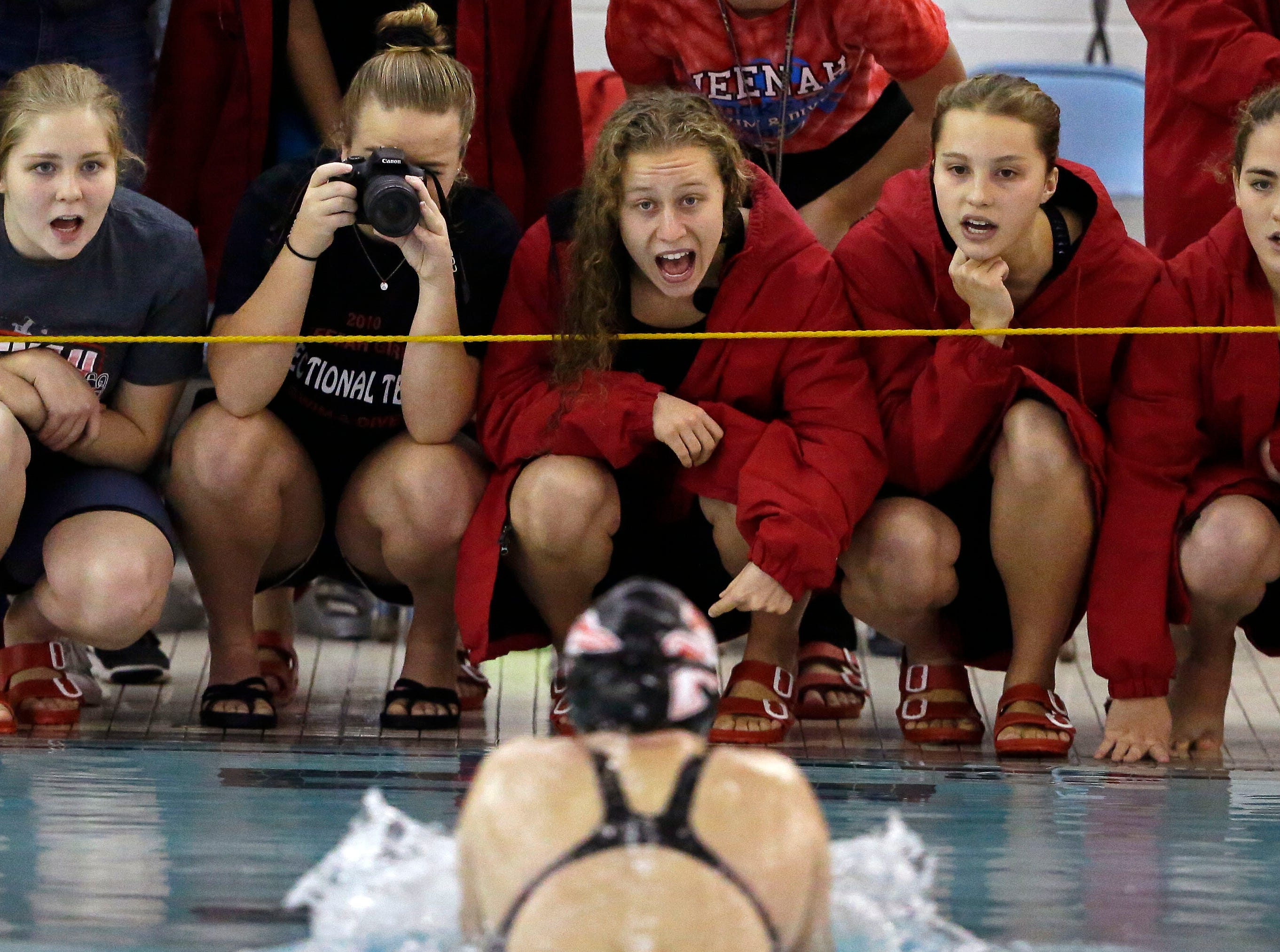 Kara Cowell of Neenah is cheered on during the 100 Yard Breaststroke as the WIAA Division 1 swimming sectional meet takes place Saturday, November 3, 2018, at Neenah High School in Neenah, Wis. Winners advanced to state.Ron Page/USA TODAY NETWORK-Wisconsin