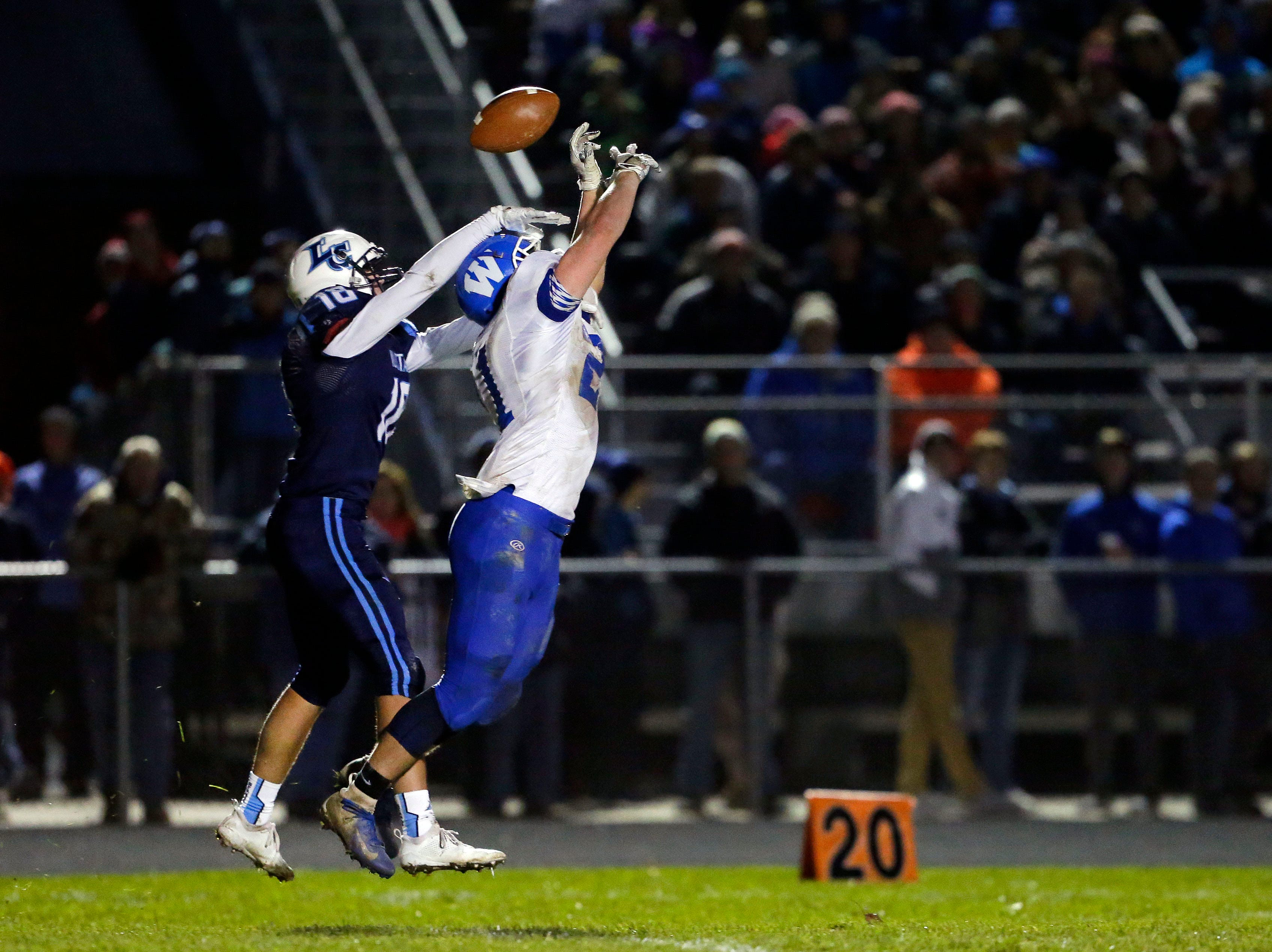 David Peeters of Little Chute defends a pass to Ben Jaeger of Wrightstown in a WIAA Division 4 Level 3 playoff game Friday, November 2, 2018, at Fitzpatrick Field in Little Chute, Wis.Ron Page/USA TODAY NETWORK-Wisconsin