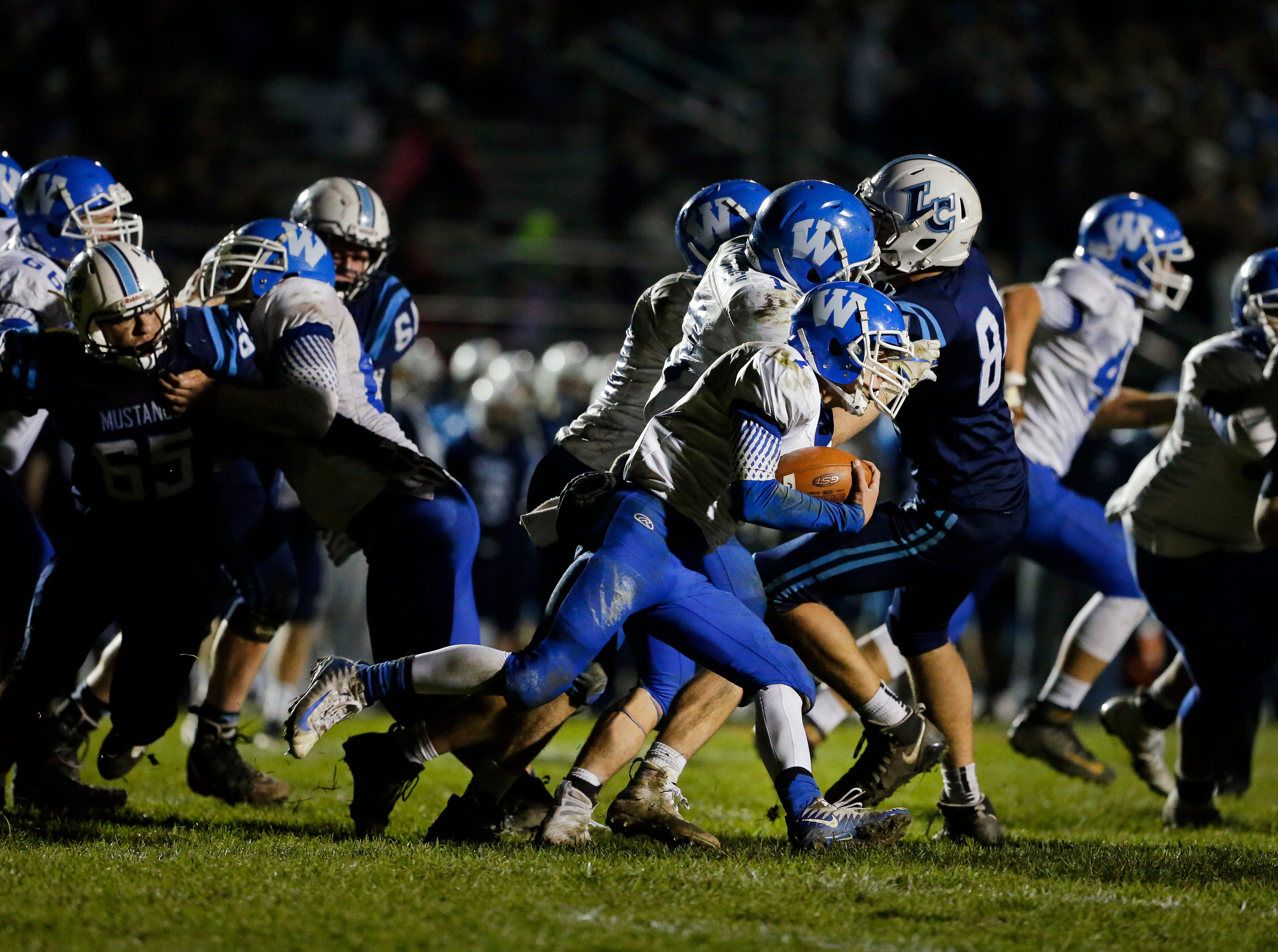 Quarterback Douglas Klister of Wrightstown carries the ball against Little Chute in a WIAA Division 4 Level 3 playoff game Friday, November 2, 2018, at Fitzpatrick Field in Little Chute, Wis.Ron Page/USA TODAY NETWORK-Wisconsin