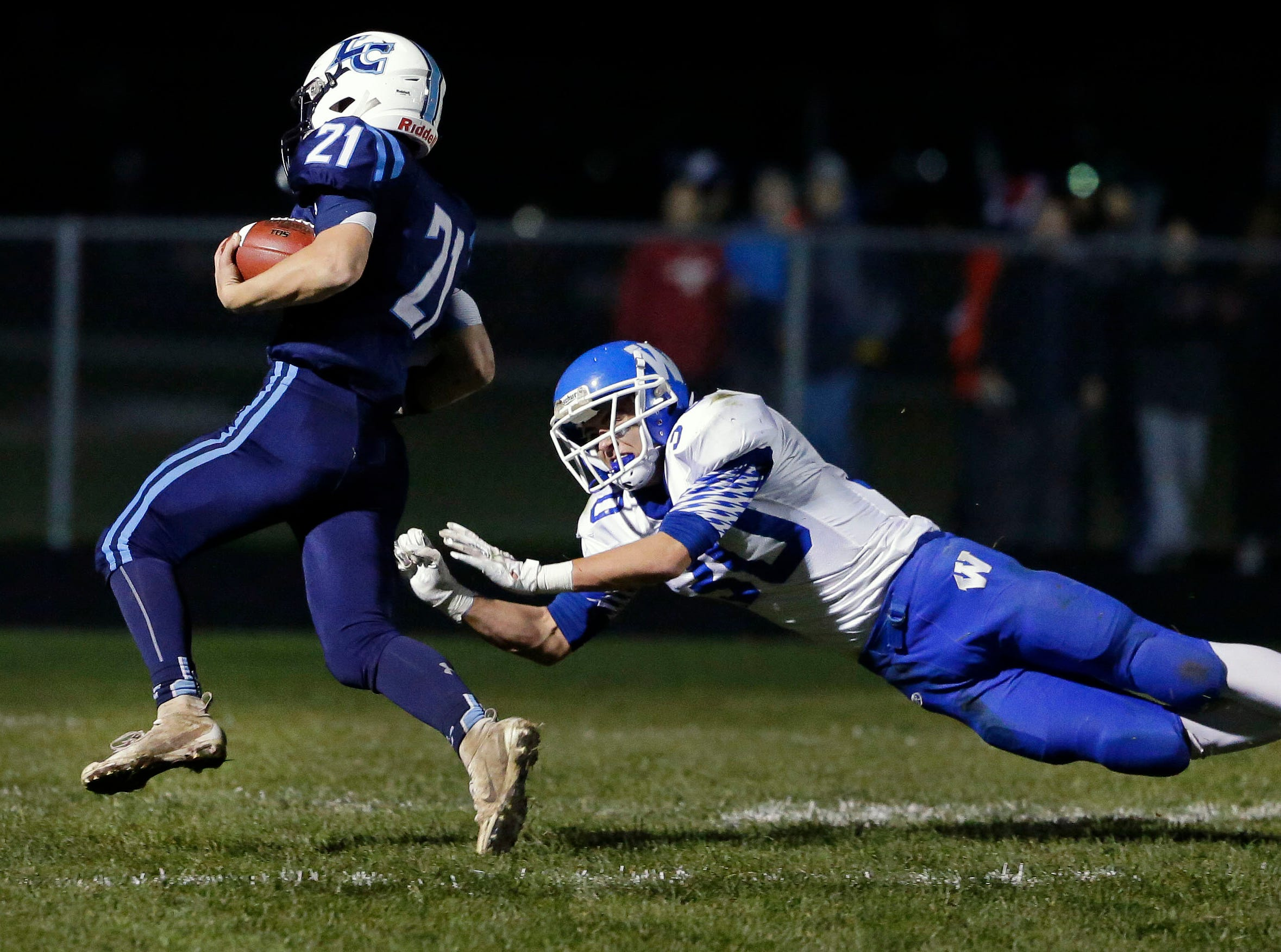 Isaac Van Deurzen of Little Chute runs for a touchdown as he gets away from Jeremy Van Zeeland of Wrightstown in a WIAA Division 4 Level 3 playoff game Friday, November 2, 2018, at Fitzpatrick Field in Little Chute, Wis.Ron Page/USA TODAY NETWORK-Wisconsin