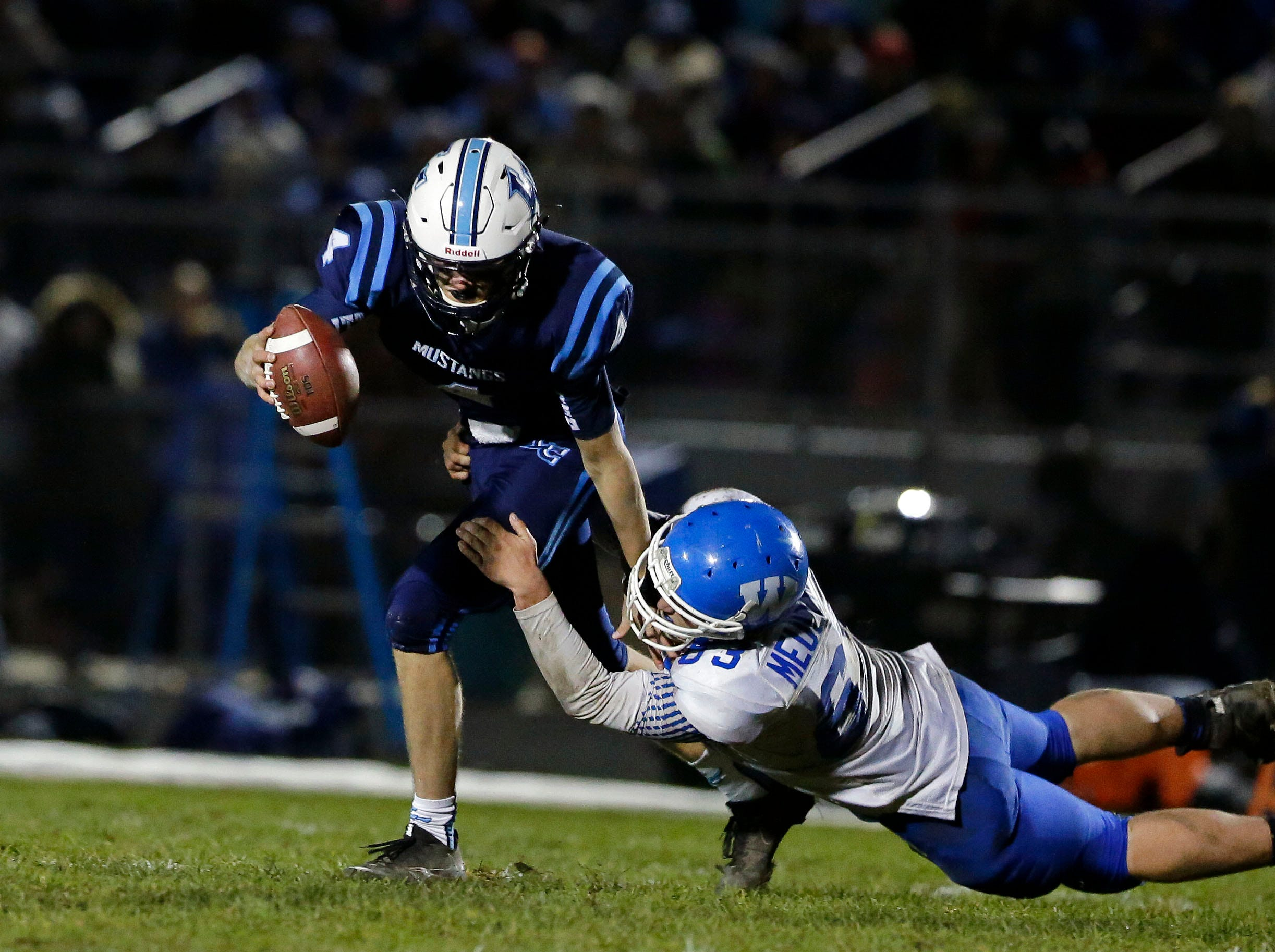 Noah Mueller of Little Chute is sacked by Hayden Meulemans of Wrightstown in a WIAA Division 4 Level 3 playoff game Friday, November 2, 2018, at Fitzpatrick Field in Little Chute, Wis.Ron Page/USA TODAY NETWORK-Wisconsin