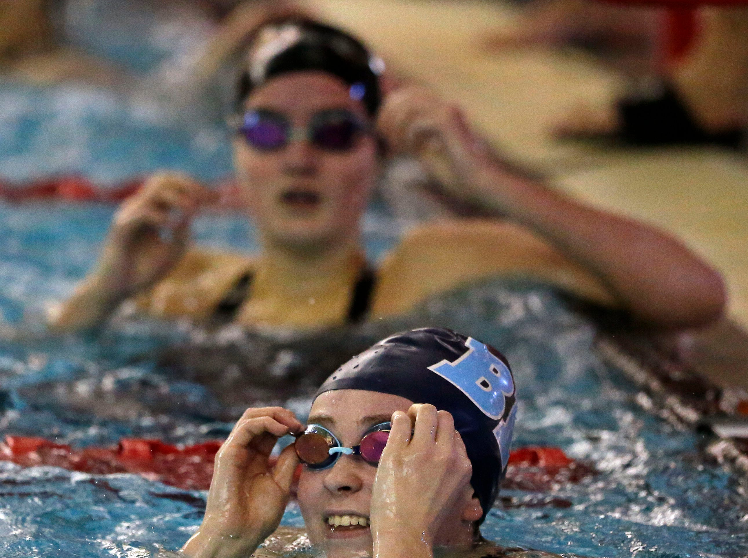 Riley Melendy of Bay Port checks the time in the 100 Yard Backstroke as the WIAA Division 1 swimming sectional meet takes place Saturday, November 3, 2018, at Neenah High School in Neenah, Wis. Winners advanced to state.Ron Page/USA TODAY NETWORK-Wisconsin