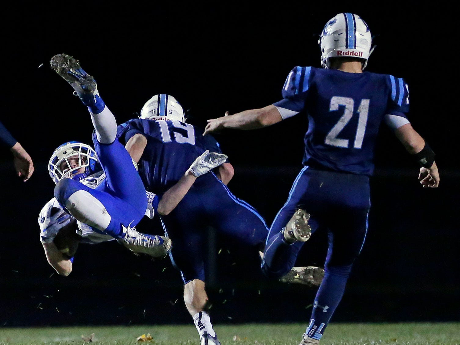Jacob Lillge of Little Chute tackles Will Braeger of Wrightstown in a WIAA Division 4 Level 3 playoff game Friday, November 2, 2018, at Fitzpatrick Field in Little Chute, Wis.Ron Page/USA TODAY NETWORK-Wisconsin
