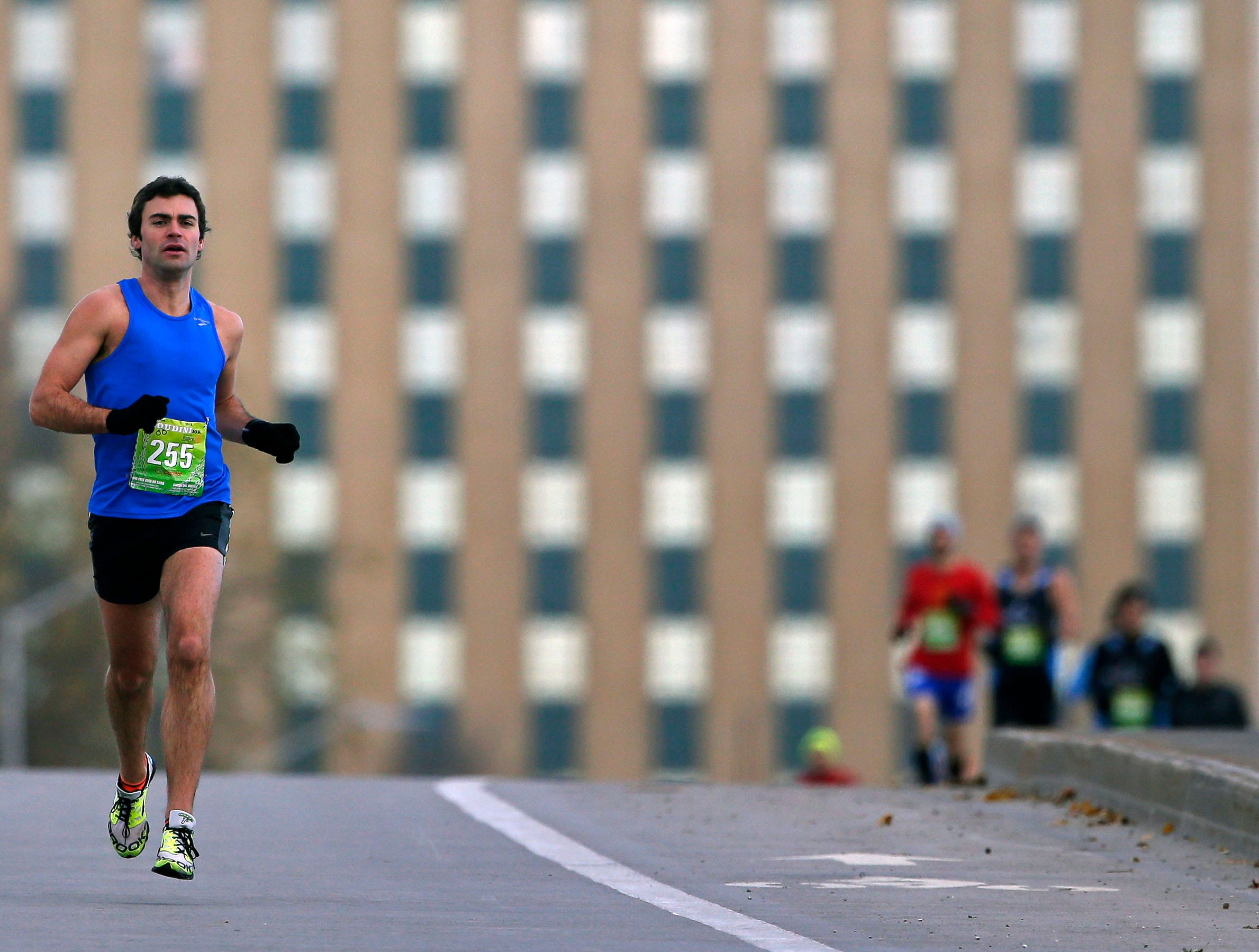 Mike Foust leads the pack at the start of the 4th annual Appleton Houdini 10K Saturday, November 3, 2018, in Appleton, Wis.Ron Page/USA TODAY NETWORK-Wisconsin