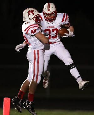 Kimberly's Caleb Frazer and Will Hammen celebrate a fourth-quarter touchdown against Bay Port on Friday in a WIAA Division 1 state quarterfinal football game in Suamico.