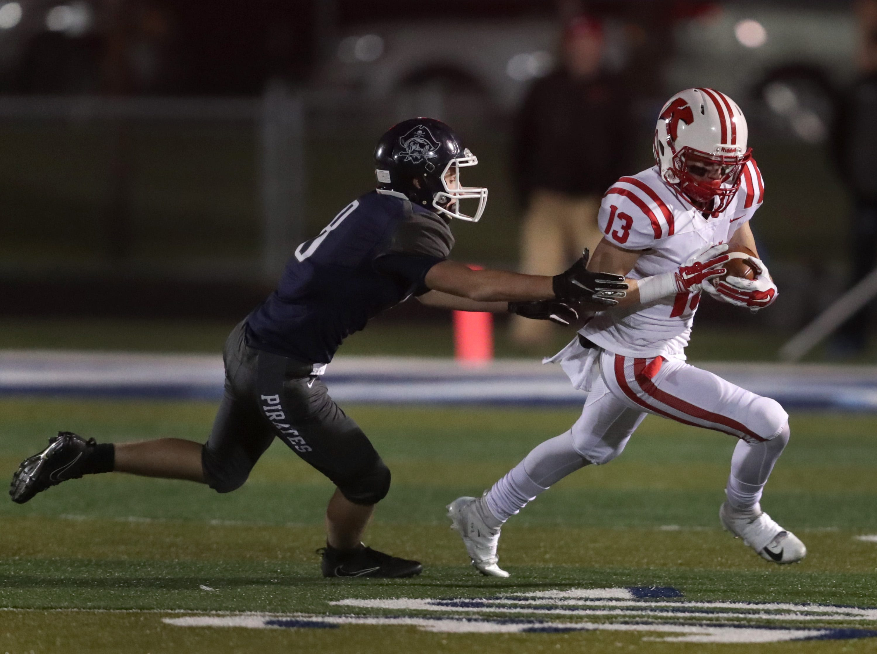Kimberly High School's #13 Zach Lechnir against Bay Port High School's #9 Jayden Montgomery during their WIAA Division 1 state quarterfinal football game on Friday, November 2, 2018, in Suamico, Wis.  Kimberly defeated Bay Port 38 to 20. Wm. Glasheen/USA TODAY NETWORK-Wisconsin.