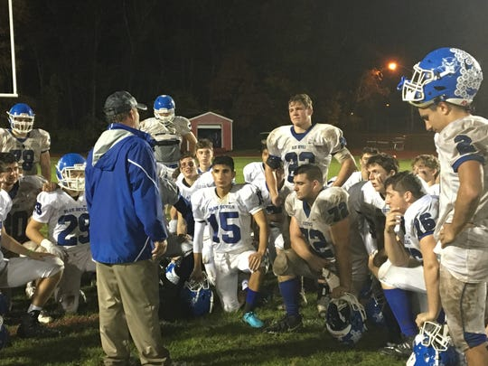 Shore football coach Mark Costantino (blue jacket) addresses his players after Friday's loss at Cinnaminson.