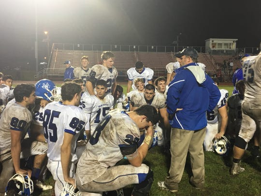 Shore football coach Mark Costantino addresses his players after Friday's playoff loss at Cinnaminson.