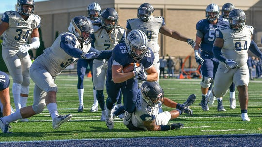 Monmouth running back Pete Guerriero  scores against Charleston Southern in the Hawks' victory on Saturday at Kessler Stadium in West Long Branch.