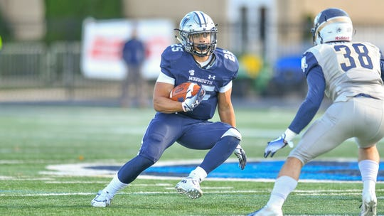 Monmouth running back Pete Guerriero  picks up yardage in the Hawks' victory over Charleston Southern on Saturday at Kessler Stadium in West Long Branch.