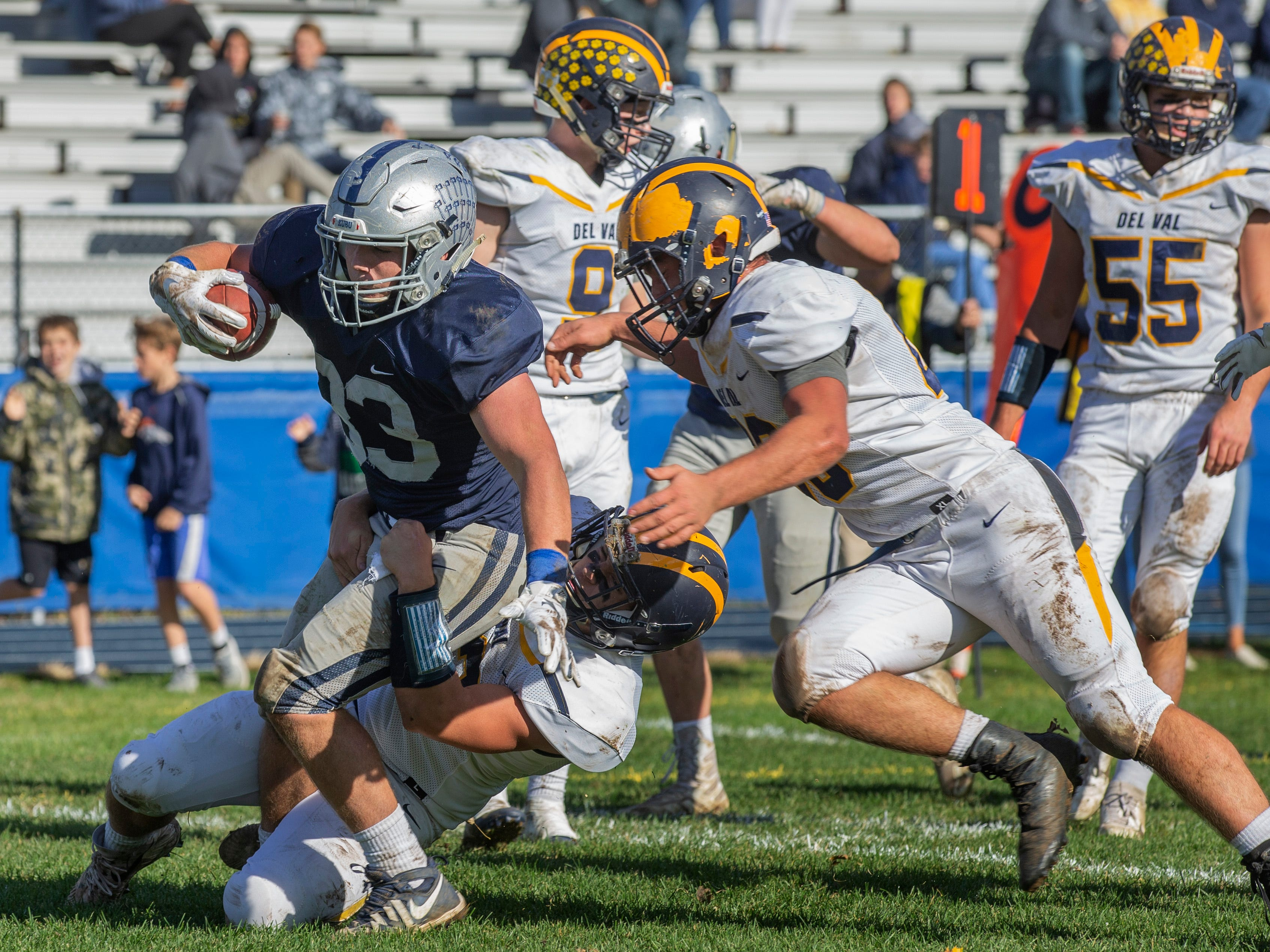 Manasquan's Zane Seal drags Delaware Valley players with him as he scores his team's second touchdown. Manasquan Football buries Delaware Valley in NJSIAA opening round game in Manasquan NJ. On November 3, 2018.