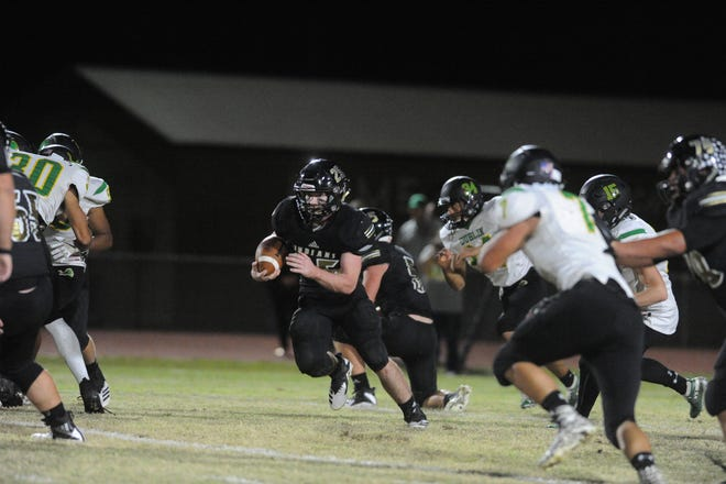 Comanche running back Kade Mercer, middle, runs through the Dublin defense during the Indians' 54-30 win Friday, Nov. 2, 2018, at Indian Stadium. Mercer finished with 199 rushing yards and four TDs.