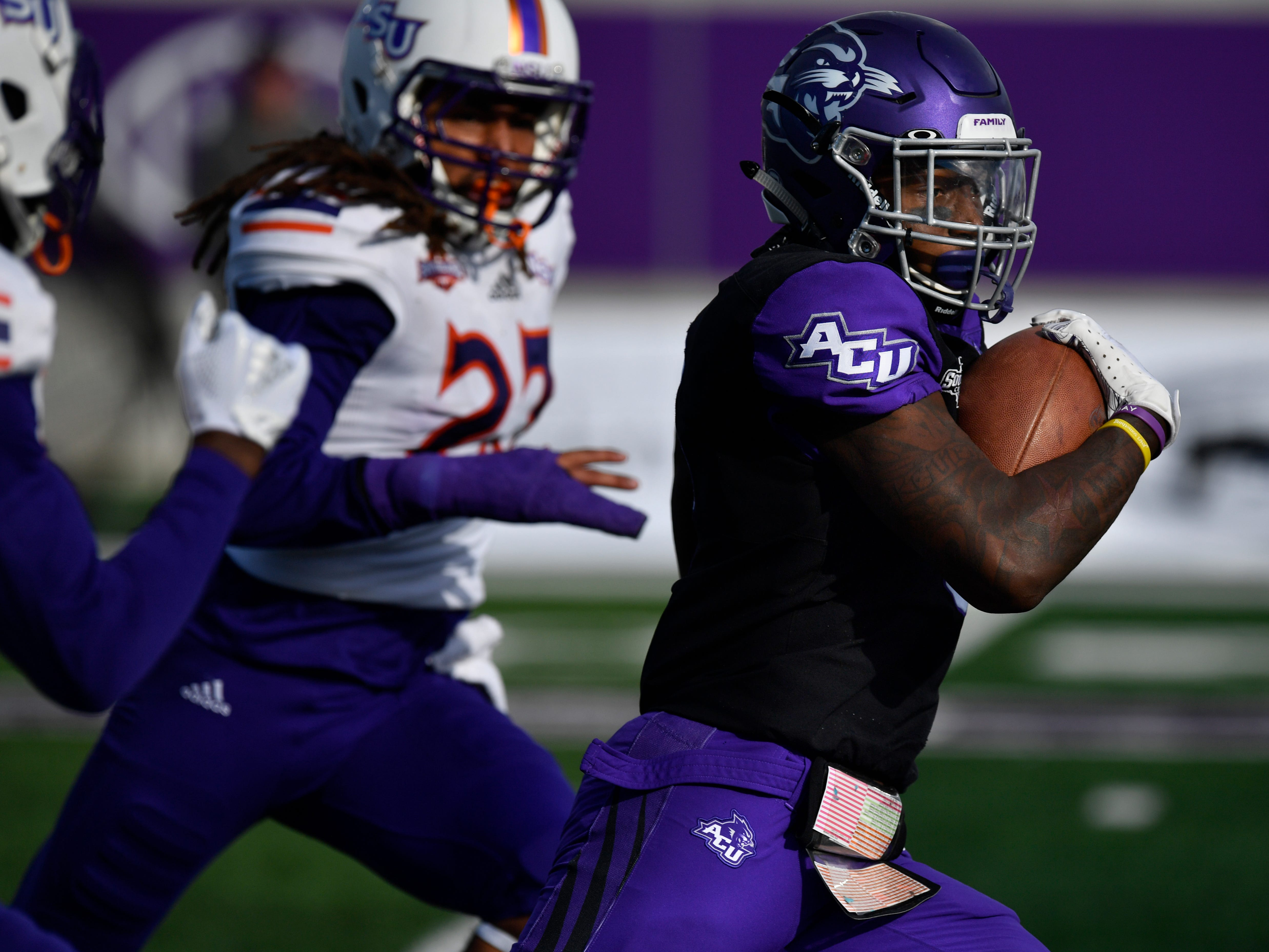 Wildcats wide receiver Kalin Sadler carries the ball downfield against Northwestern State Saturday Nov. 3, 2018. Final score was 49-47, Abilene Christian University.