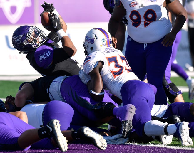 Wildcats running back Tracy James holds up the ball after scoring a two-point conversion late in the game against Northwestern State University Saturday Nov. 3, 2018. Final score was 49-47, Abilene Christian University.