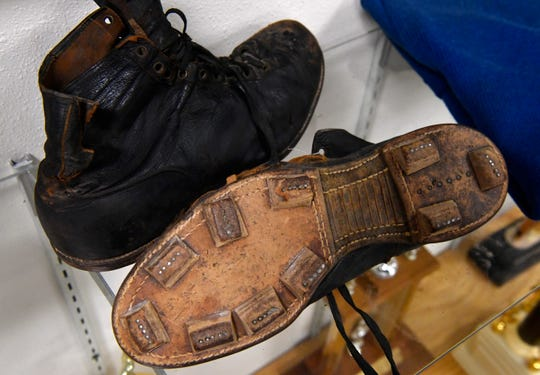 Leather 1915 Spalding football cleats, on display at Stamford's Cowboy Country Museum. Jewellee Kuenstler, the museum curator, said the volunteer football players from Stamford High School like to remark how painful the leather tabs and their nails appear to them.
