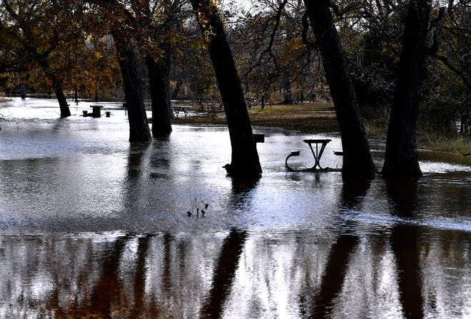 Picnic tables are surrounded by high water Thursday at Abilene State Park. According to the state climatologist, September and October were the two wettest months in the state history.