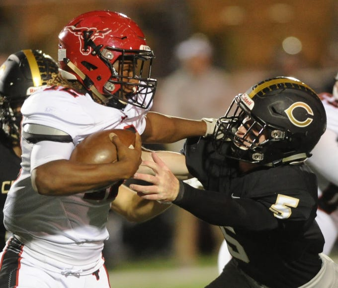 Eastland's Dom Jones, left, tries to evade Clyde's Jax Roam during the first half of their District 3-3A Division I game Friday, Nov. 2, 2018, at Clyde. Eastland rallied from a 14-7 halftime deficit to beat the Bulldogs 28-14.