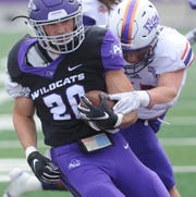 ACU running back Billy McCrary runs 4 yards for a TD as a Northwestern State player defends. The TD gave the Wildcat a 14-7 lead with 3:42 left in the first quarter of their Southland Conference game Saturday, Nov. 3, 2018, at Wildcat Stadium.