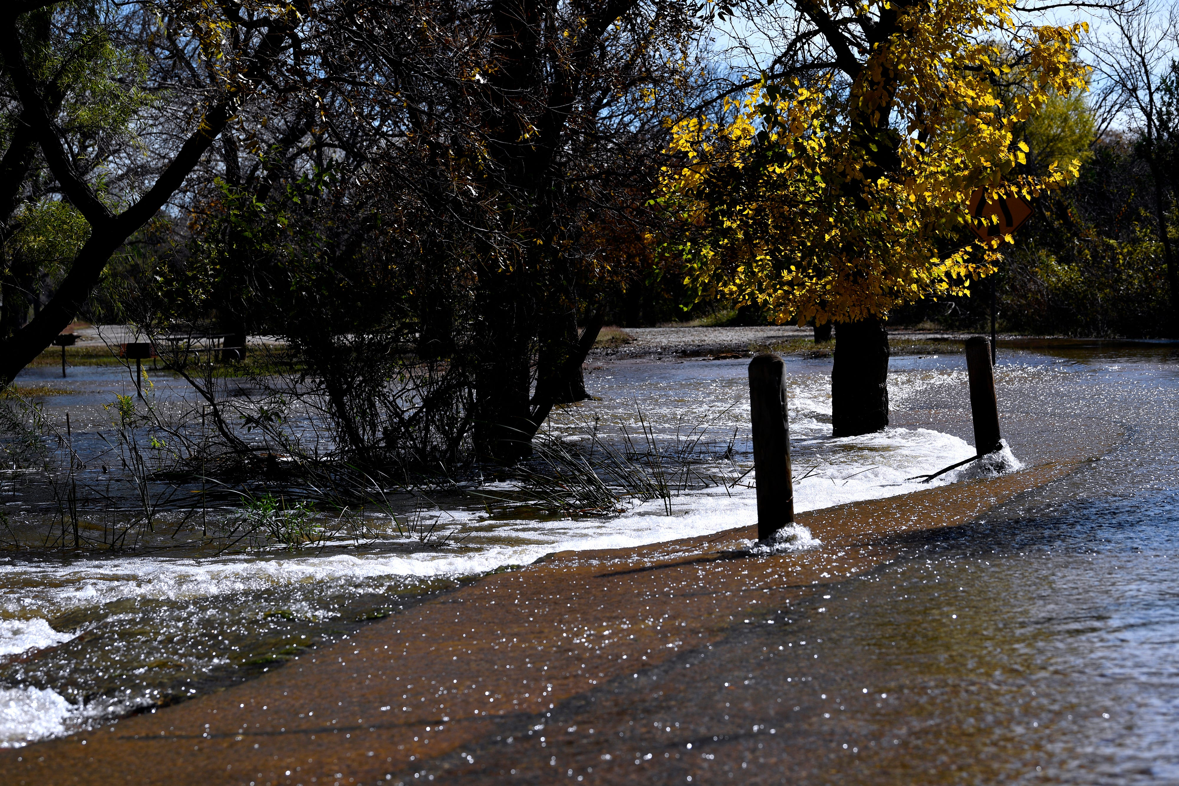 Water flows across a road Thursday at Abilene State Park. Runoff from heavy rains closed the park last month, which reopened Thursday with limited access. September and October were the two wettest months in the state's history.