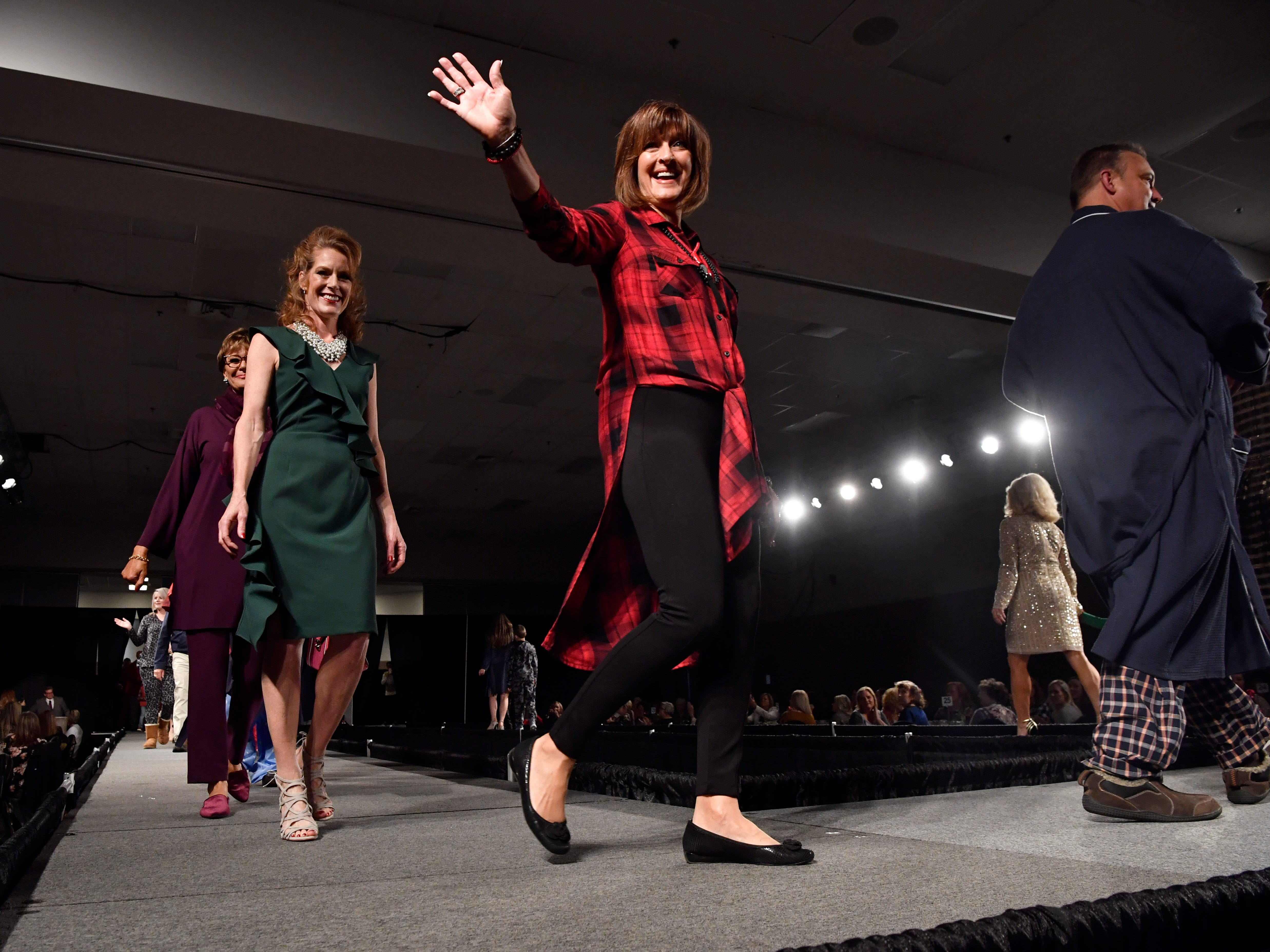 Nancy Smith waves to the crowd at the conclusion of the fashion show luncheon during Friday's Junior League of Abilene Christmas Carousel Nov. 2, 2018. The holiday shopping event at the Abilene Convention Center ends Sunday.