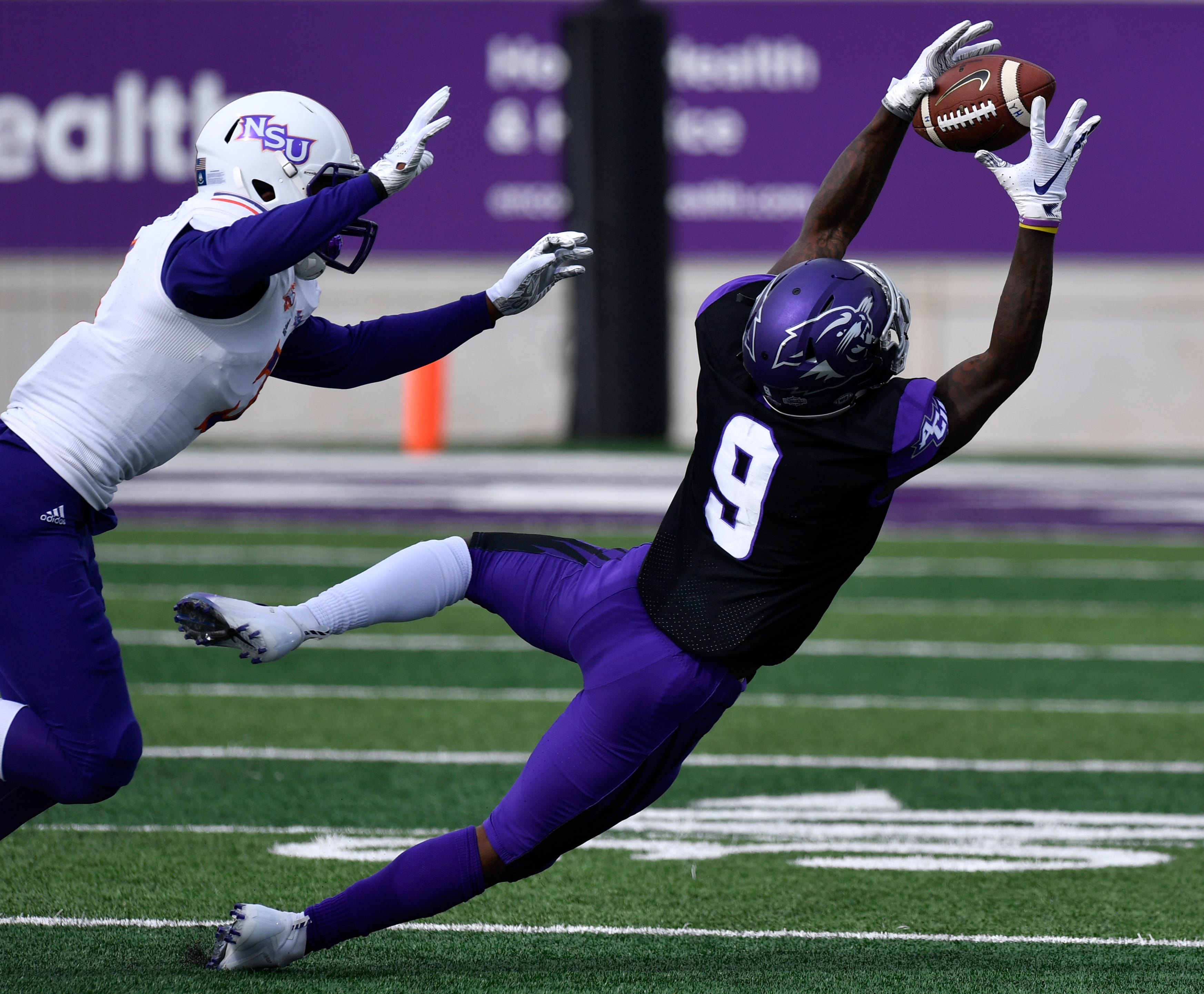 Wildcats wide receiver Kalin Sadler completes a pass during Saturday's game against Northwestern State University Nov. 3, 2018. Final score was 49-47, Abilene Christian University.