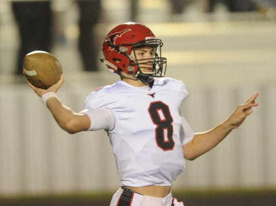 Eastland quarterback Behren Morton readies to throw a pass against Clyde during the first half of their District 3-3A Division I game Friday, Nov. 2, 2018, at Clyde. Eastland rallied from a 14-7 halftime deficit to beat the Bulldogs 28-14.