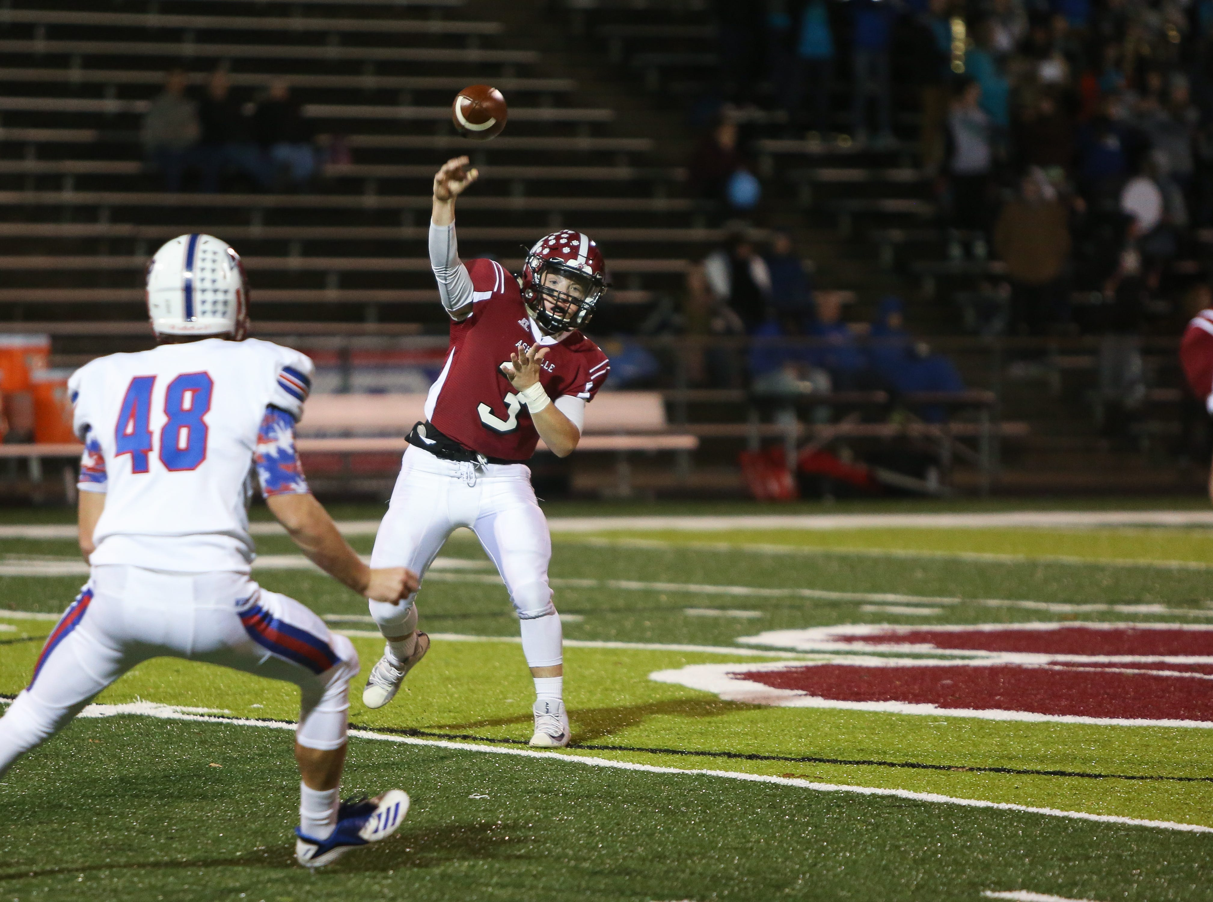 Asheville quarterback Three Hillier throws the ball as Asheville faced off against West Henderson on Nov. 2, 2018, at Asheville.  The Cougars took the win with a final score of 24-13.