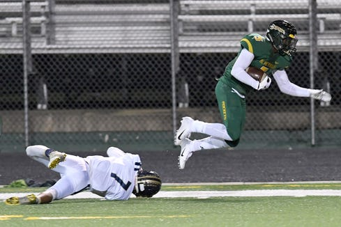 Reynolds' Jhari Patterson escapes a tackle from Roberson's Hunter Maddox during their game at Reynolds High School on Nov. 2, 2018. The Rockets defeated the Rams 55-28.