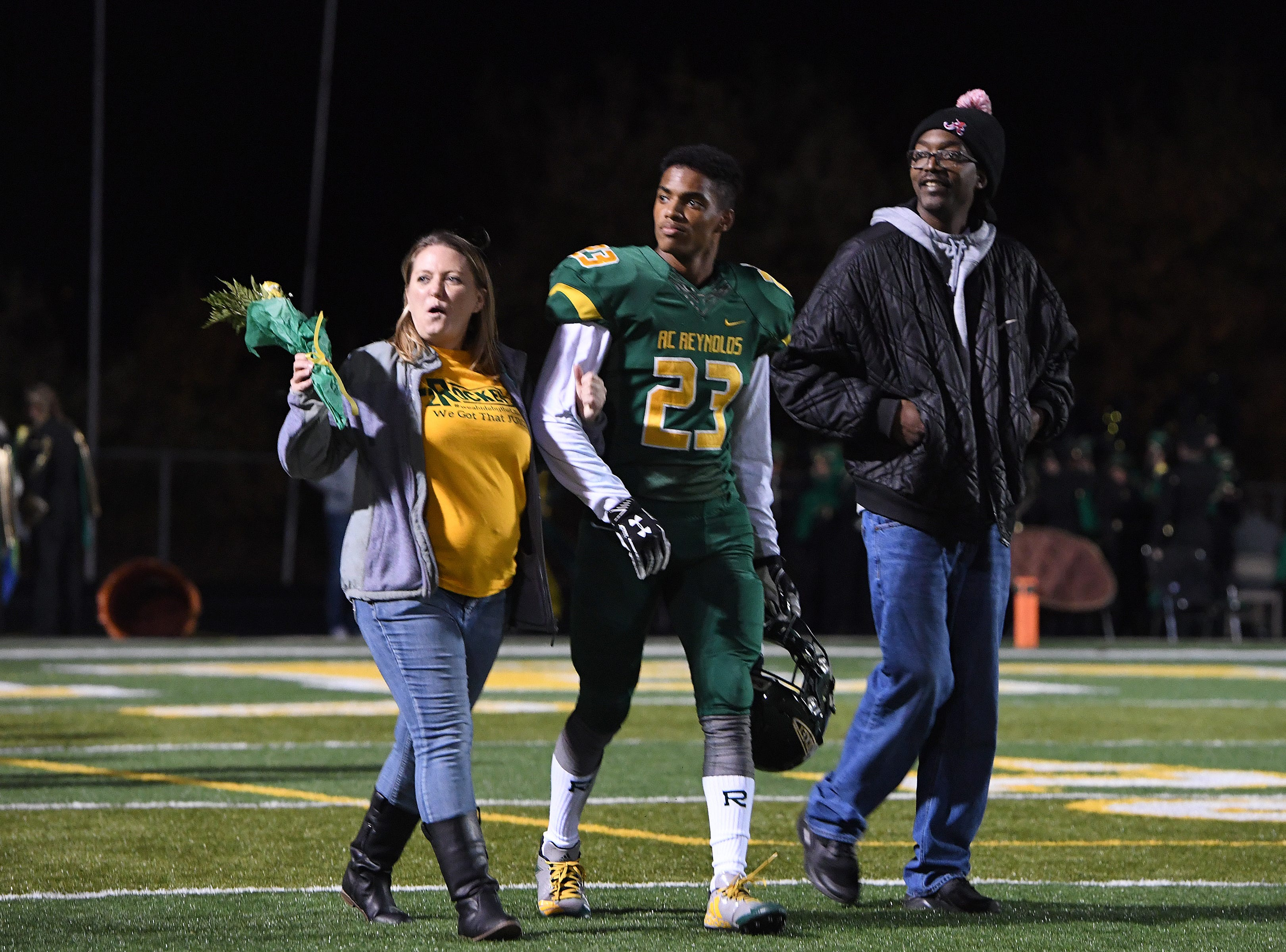 Senior football players, cheerleaders and band members were honored during the final home game of the regular season at Reynolds High School on Nov. 2, 2018.