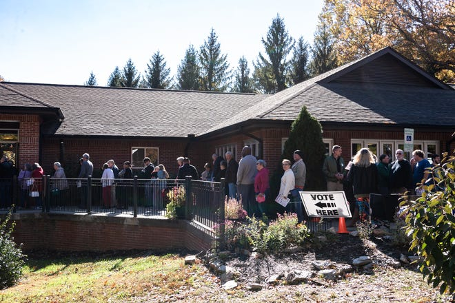 People wait in line for early voting at the South Buncombe Library on Nov. 3, 2018.