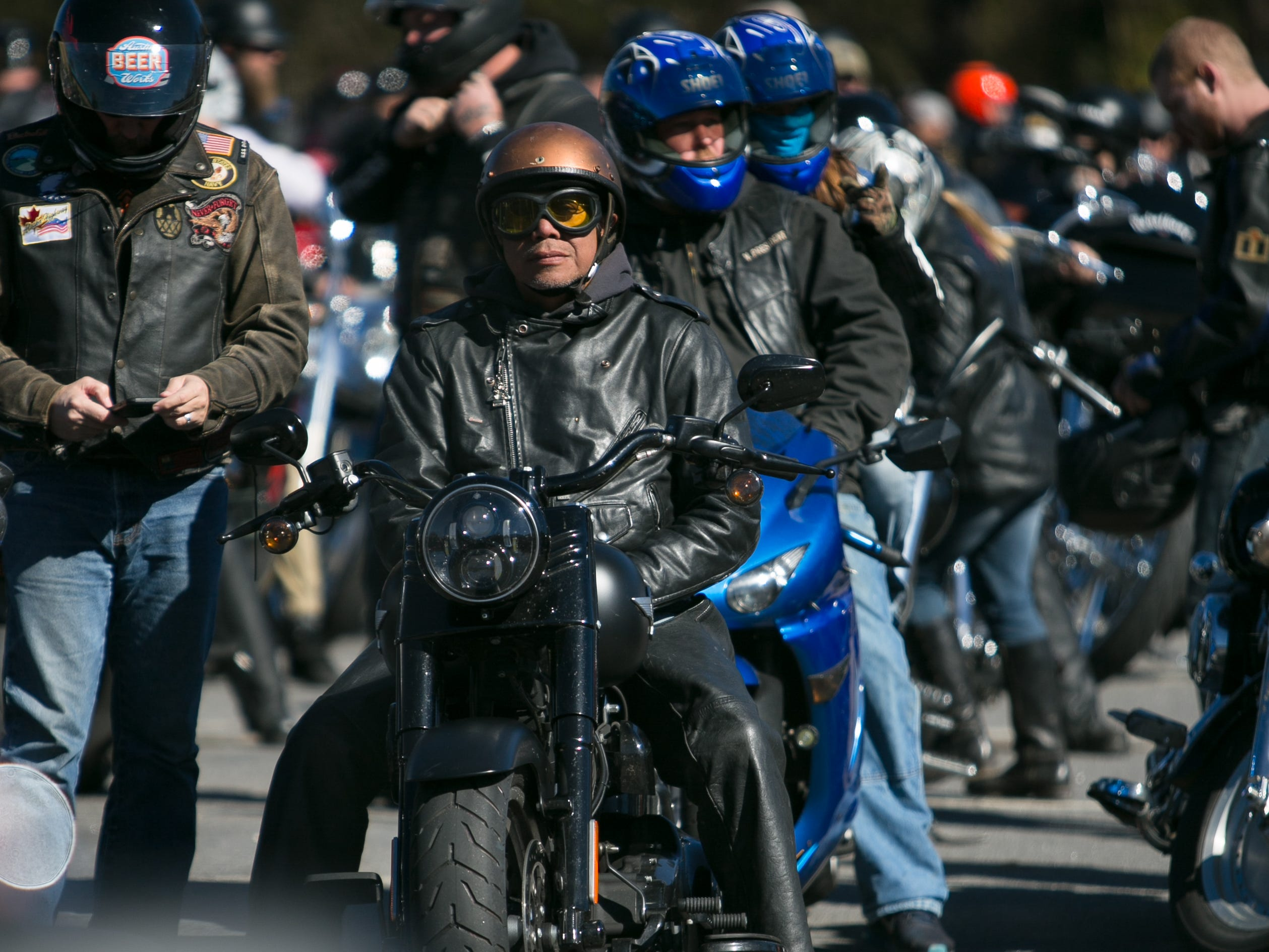 Scenes from the 38th annual Smoky Mountain Toy Run, held Saturday. The motorcycle ride began at Kearfott Manufacturing in Swannanoa and ended at City/County Plaza in downtown Asheville. The event is held to collect toys and money for the Eblen Charities' Saint Nicholas Project, which distributes toys to needy families during the Christmas season.