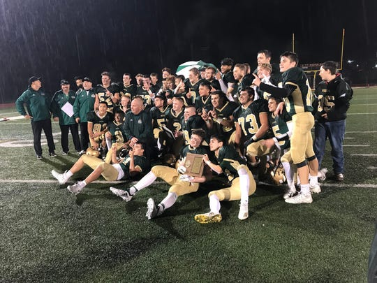 Vestal players celebrate following their 27-13 victory over Union-Endicott in Friday night's Section 4 Class A final at Ty Cobb Stadium.