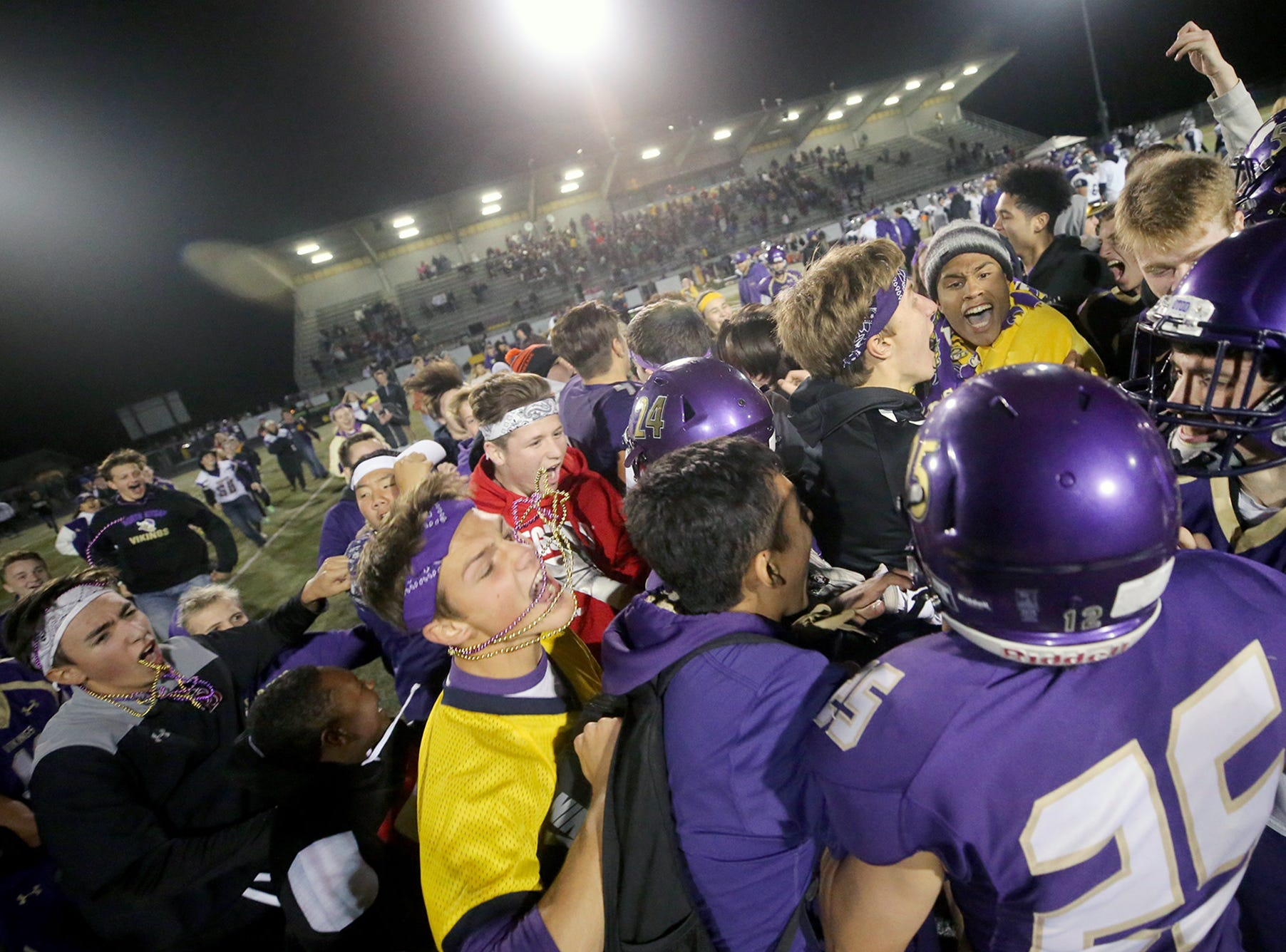 The North Kitsap Vikings defeated River ridge in a West Central District playoff game at North Kitsap on Friday, November 2, 2018. North Kitsap  player Isaiah Kahana stiff arms River RidgeÕs Isaiah Parker.Players and fans celebrate the victory.