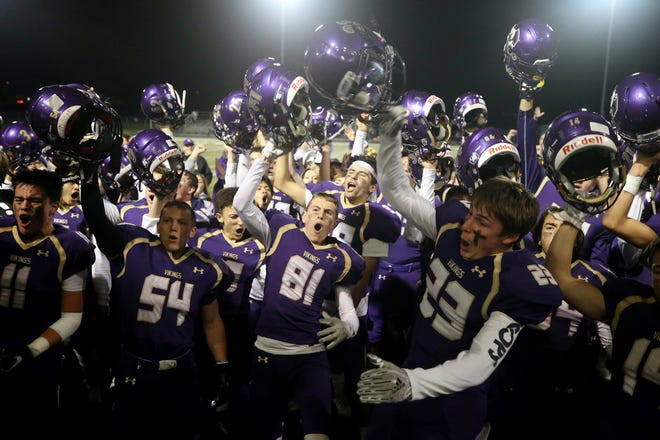 North Kitsap players celebrate after Friday's victory over River Ridge in a Class 2A West Central District playoff game in Poulsbo. The Vikings clinched a state playoff berth for the fifth consecutive year.