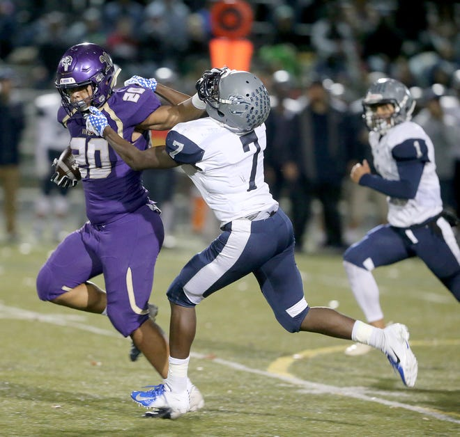 North Kitsap running back Isaiah Kahana rushed for 228 yards and scored two touchdowns in the Vikings' 33-22 comeback win over River Ridge in a Class 2A West Central Distrit playoff game in Poulsbo on Friday.
