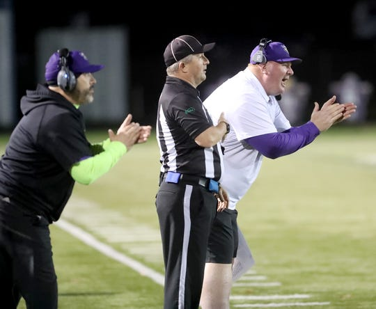 """North Kitsap head coach Jeff Weible (right) called Friday's district playoff win over River Ridge the """"most gratifying"""" win of his career."""