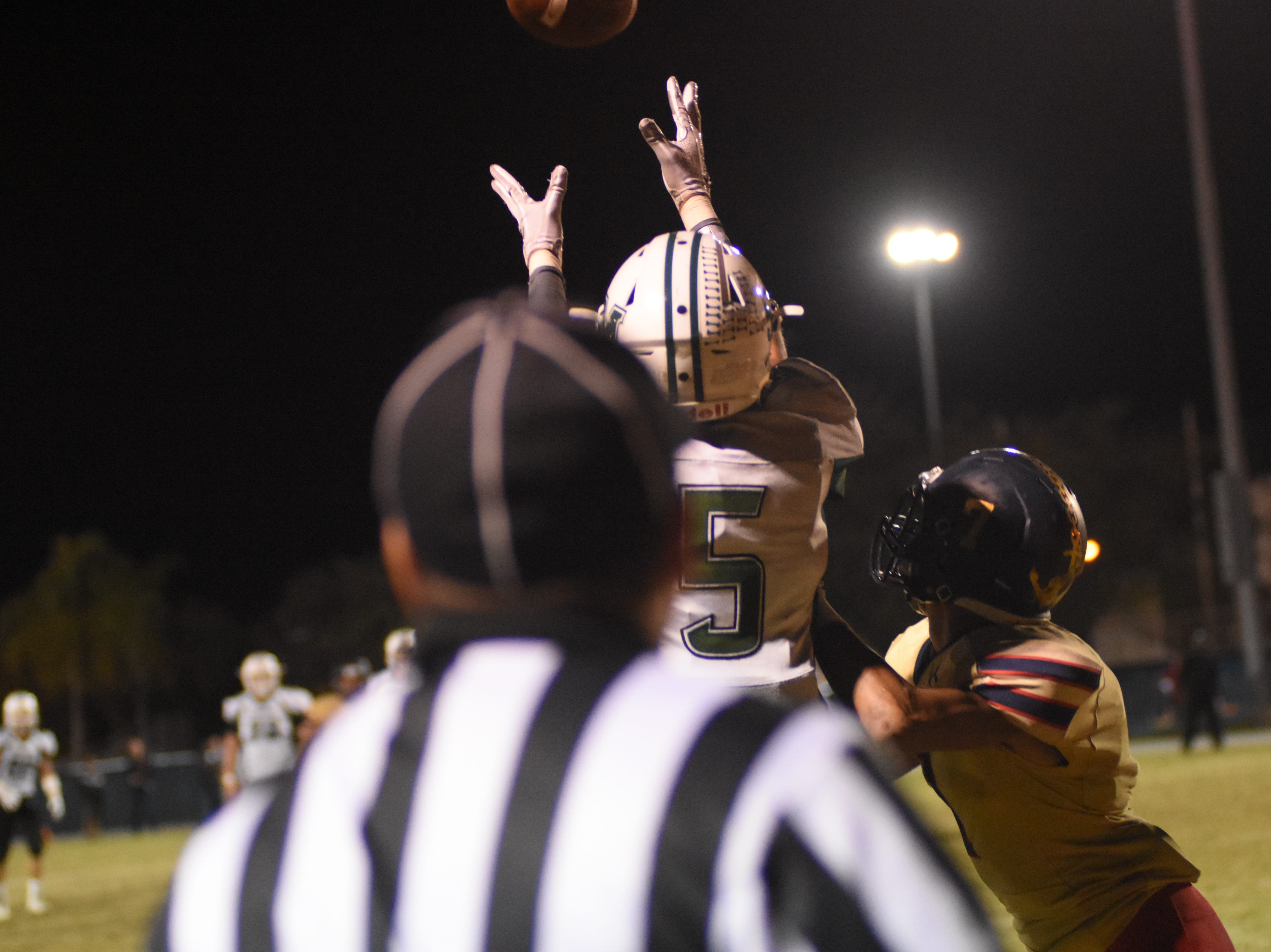 Melbourne's Khalib Gilmore (5) leaps for a touchdown pass during the third.