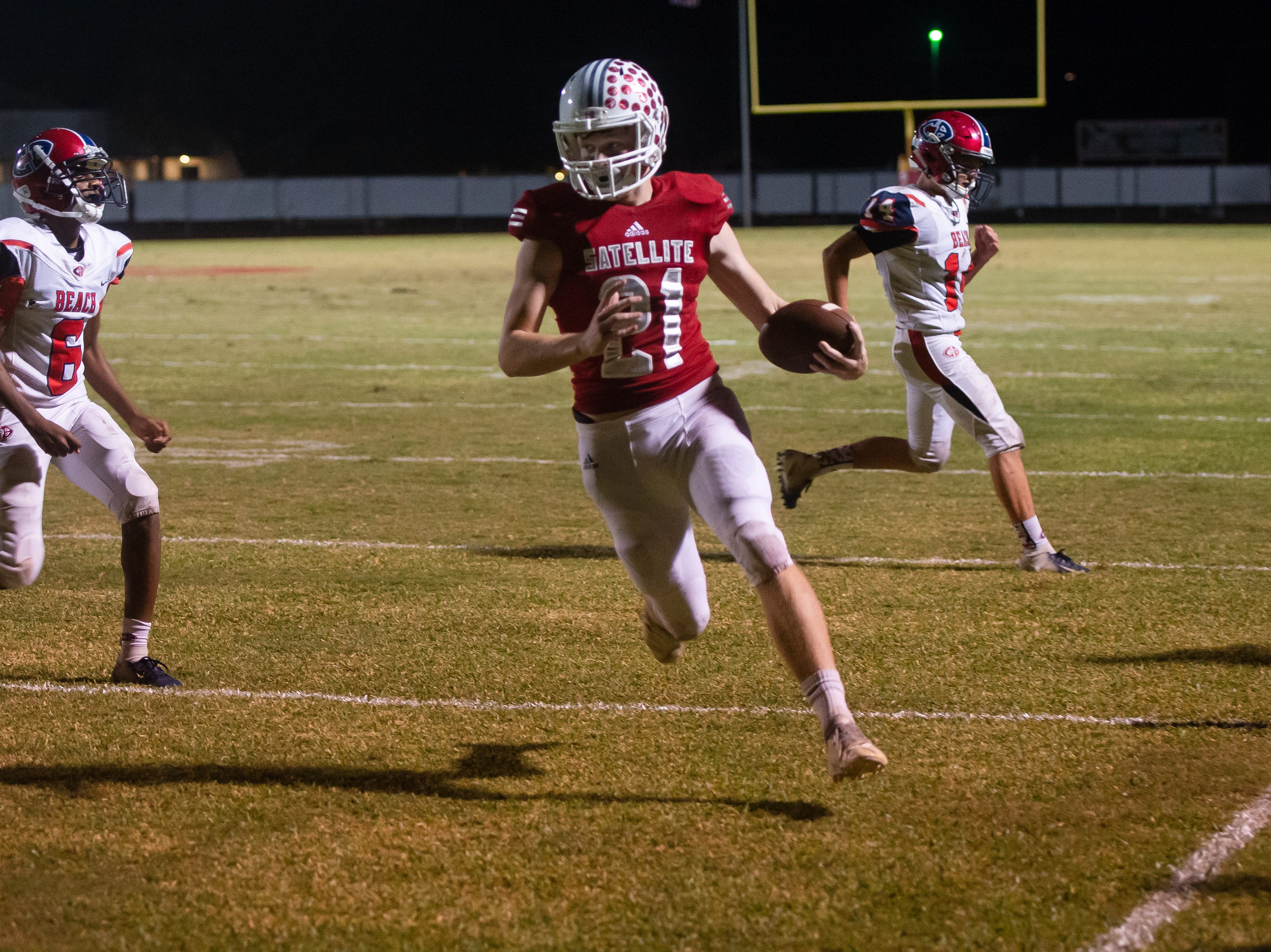 Trey Brown scores a two-point conversion for Satellite High during the game against Cocoa Beach.