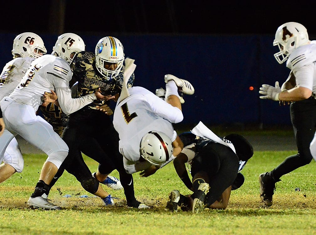 Jalen Butler trips up War Eagle quarterback Connor Ferguson Friday night as the Terriers hosted Astronaut.