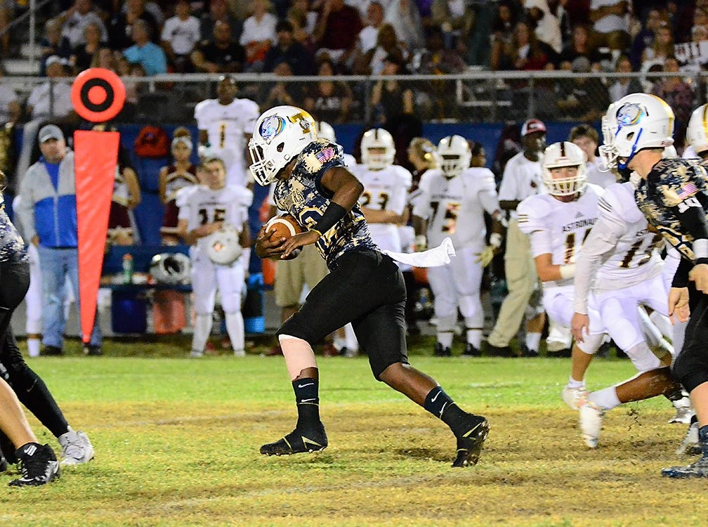 Terrier Chandler Hunt carries the ball Friday night for Titusville.