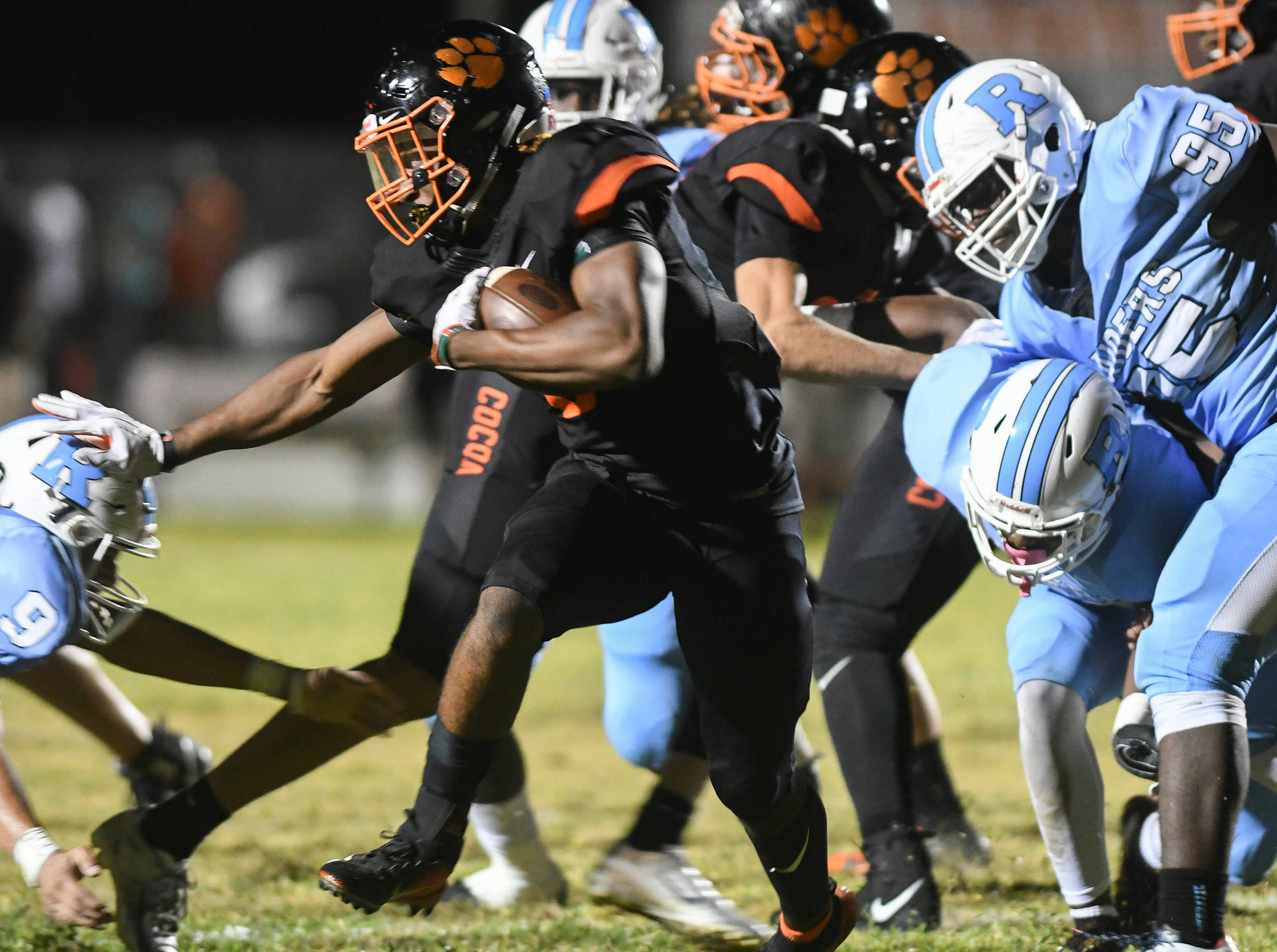 Cocoa's Caziah Holmes (8) runs the ball during Friday's game.