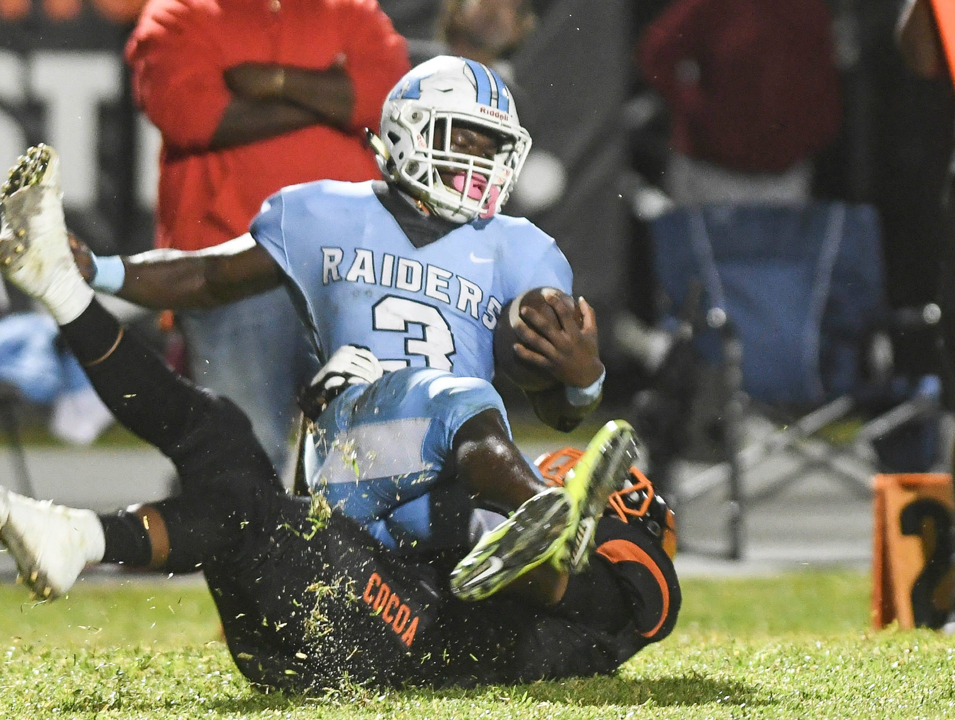 Rockledge's Ladarius Tennison is brought down by Ja'von Wade oc cocoaduring their game Friday