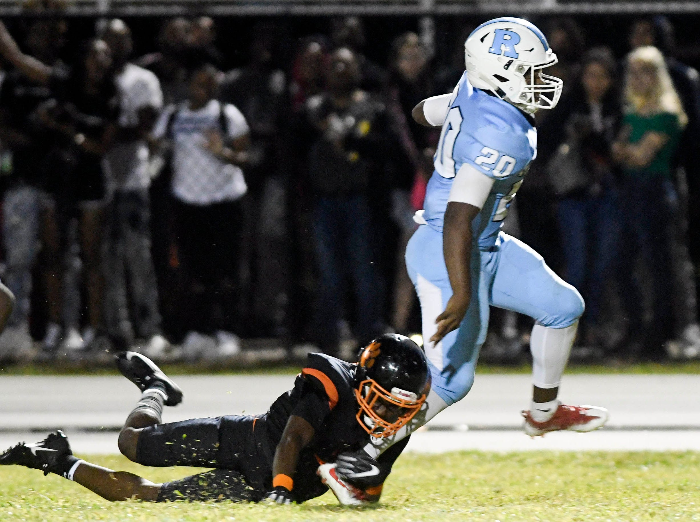 Avery Smith of Rockledge (20) gets around OJ Ross of Cocoa and returns a Cocoa interception for a touchdown during Friday's game.