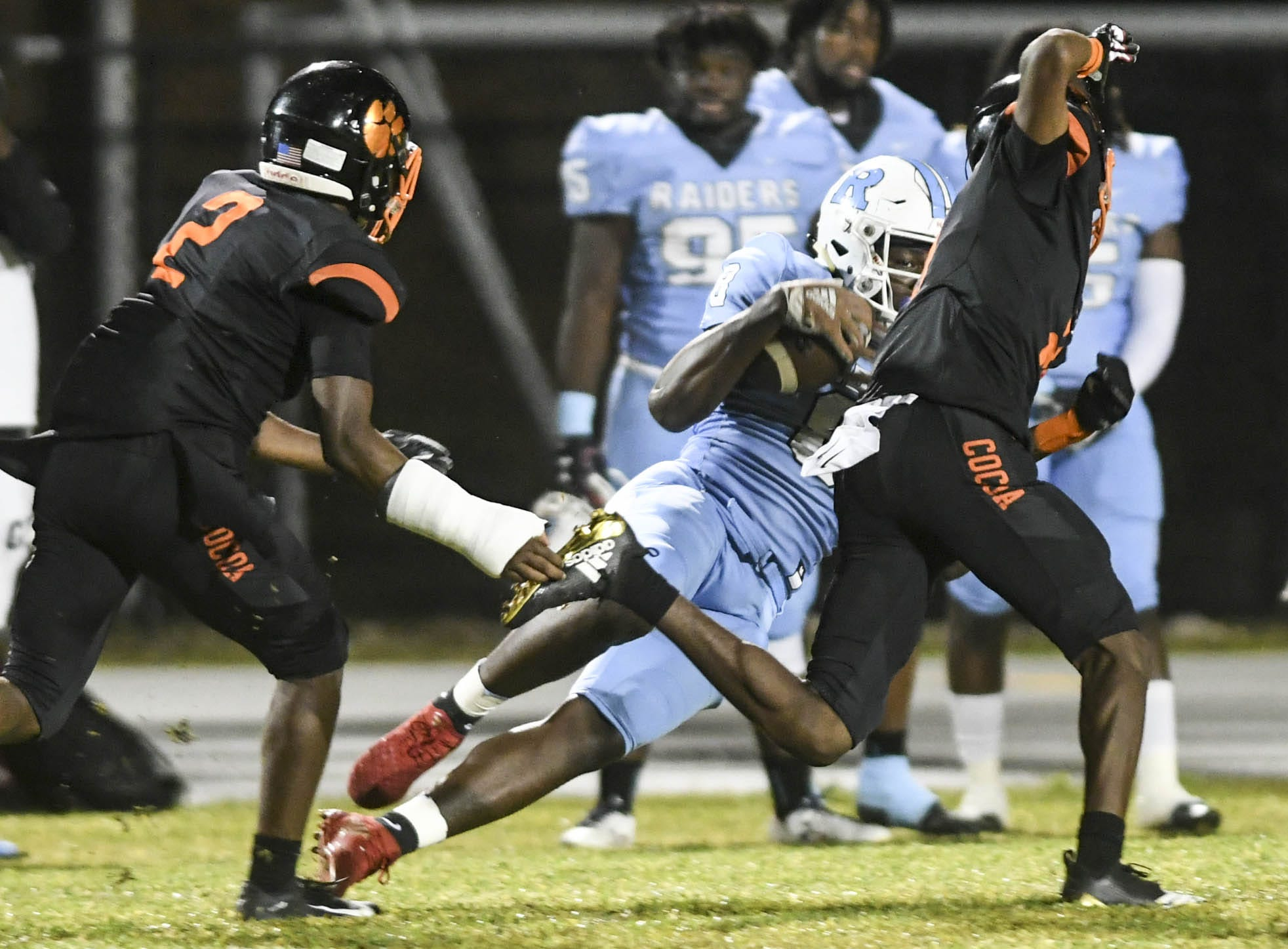 OC Brothers of Rockledge catches a long pass during Friday's game against Cocoa.