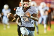 Ladarius Tennison of Rockledge runs the ball during a game against Cocoa.