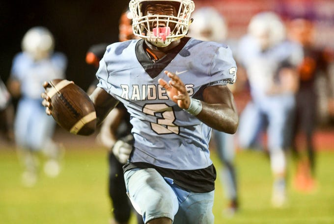 Ladarius Tennison of Rockledge runs the ball during Friday's game against Cocoa.